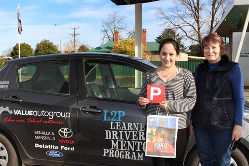 L2P driver and mentor next to the L2P car